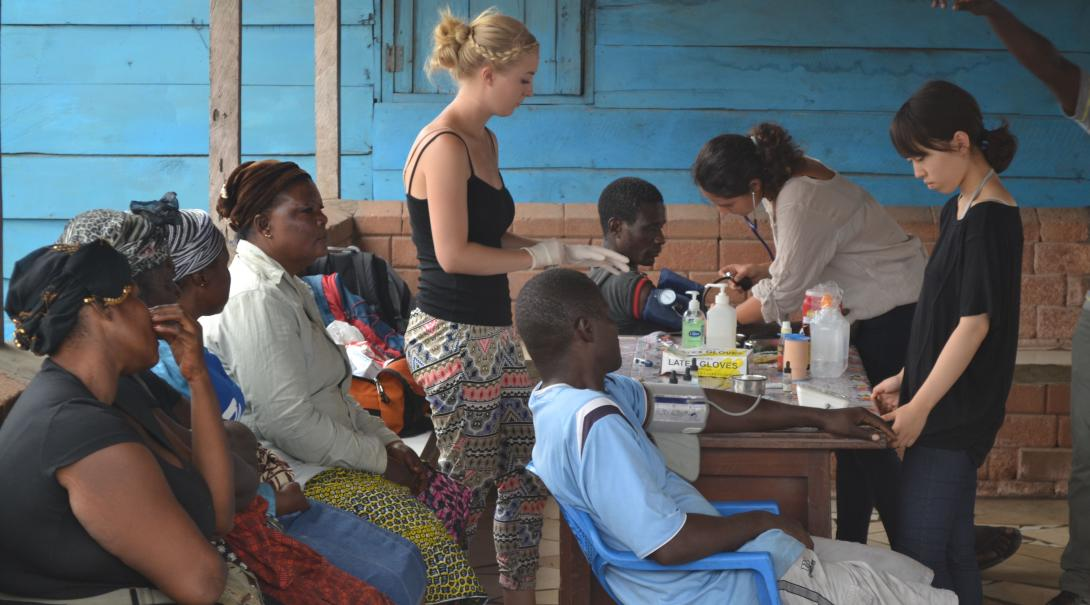 A group of Projects Abroad volunteers doing Public Health internships in Madagascar with Projects Abroad conduct a medical outreach.